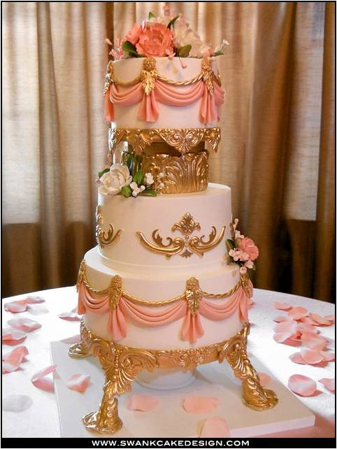 This cake looks too good to eat, and goes back to the principle colors of the theme with gold and dusky pink hues. Stunning.