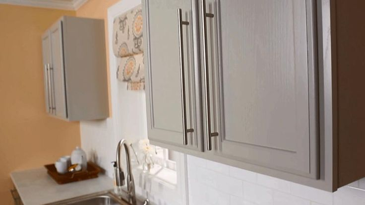Watch and see how to install new hardware on your kitchen cabinets.
