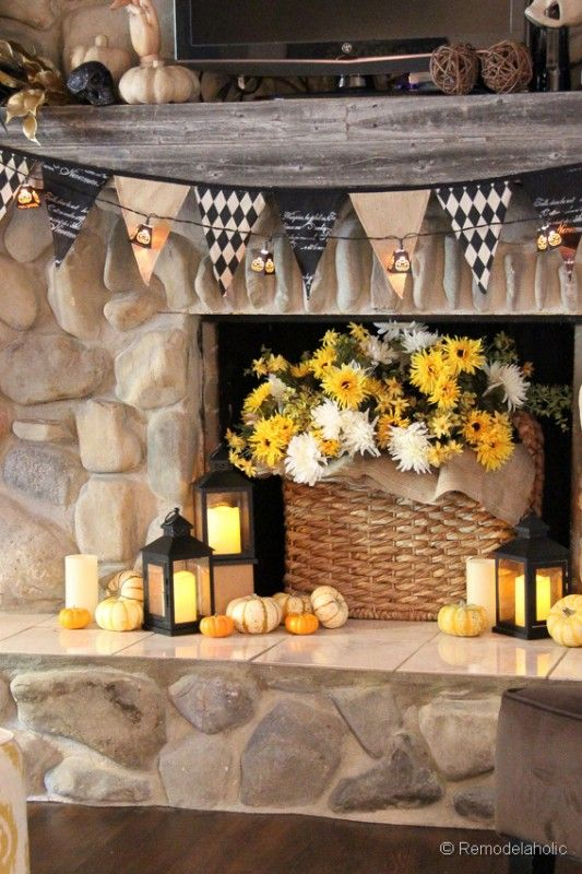 Fall and Halloween Mantel Decor. Love that this has a big ol' tv in the middle to work around like mine...gives me hope