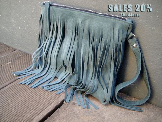 Check out this item in my Etsy shop https://www.etsy.com/listing/226782618/sales-boho-style-fringe-clutch-with