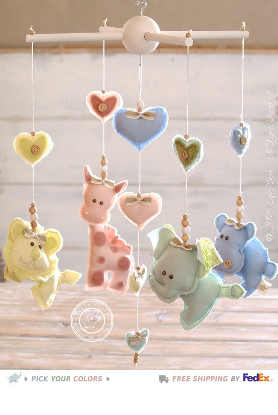 Im proud to introduce you a Safari Baby Mobile to catch babys eyes! Elephants, Lions, Giraffes, Hippos and colorful baby hearts are showing off in shades of four light pastel colors: blue, pink, yellow and mint green. This is the best gift for the fun of your baby in a nursery decored with a safari theme. Give Lolly Cloths little friends to a special Little One! ★ ▬ FREE WORLDWIDE SHIPPING - FAST DELIVERY ▬ ★ This item is Made-To-Order. The completion time is about 3-4 WEEKS. The package…