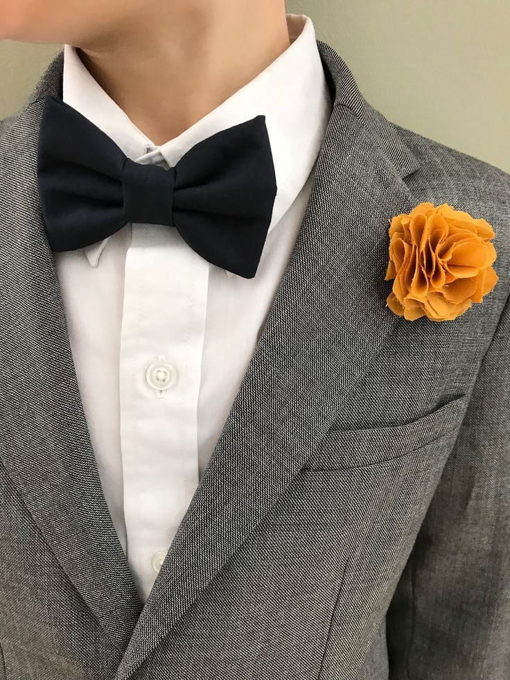 Boys bow tie and flower lapel.