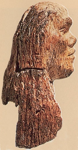 Ancient carved ivory portrait a Cromagnon man from Brno found en 1891