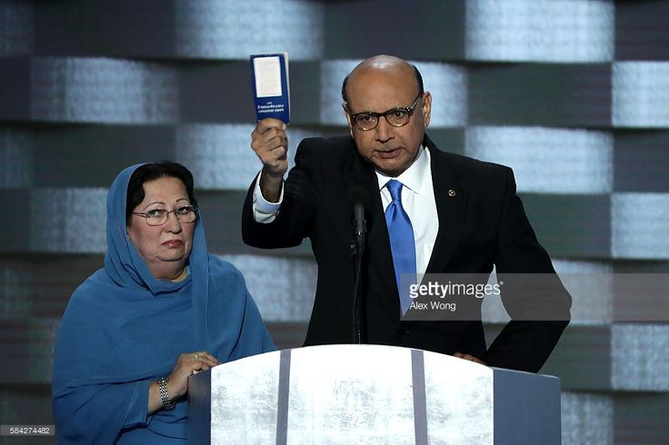 Khizr Khan, father of deceased Muslim U.S. Soldier Humayun S. M. Khan, holds up a booklet of the US Constitution as he delivers remarks on the fourth day of the Democratic National Convention at the Wells Fargo Center, July 28, 2016 in Philadelphia, Pennsylvania. Democratic presidential candidate Hillary Clinton received the number of votes needed to secure the party's nomination. An estimated 50,000 people are expected in Philadelphia, including hundreds of protesters and members of the…