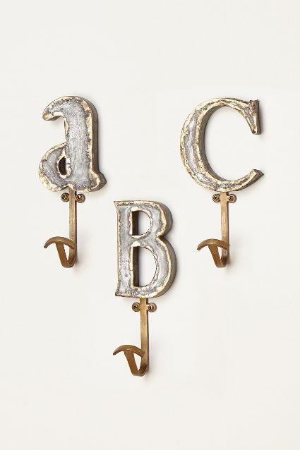Marquee Letter Hook - anthropologie.com.  Great hooks for the kids' bedroom (C & G).  A place for them to hang towels, jackets, etc. Metal works with iron beds.