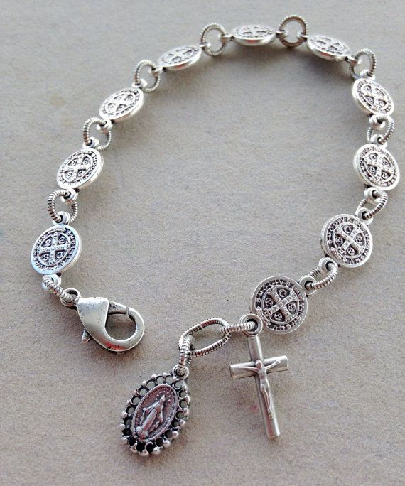 BACK IN STOCK!!  This simple, beautiful bracelet is made with 10 oxidized silver St. Benedict medals representing one decade of the rosary. Each medal is joined by an antique silver plated corrugated jump ring. The lobster clasp is antique silver plated brass. A fancy Miraculous Medal and simple crucifix hang at the end of the bracelet. From end to end this bracelet is 8 inches long with some adjustability in the length.  All antique silver parts are plated with .999 Fine Silver.