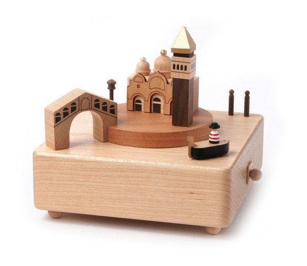 A beautifully handcrafted wooden music box featuring - Hidden rail design - Small parts rotate around stationary parts - One-touch to stop music - Made from real wood - Japan Sankyo music movement use