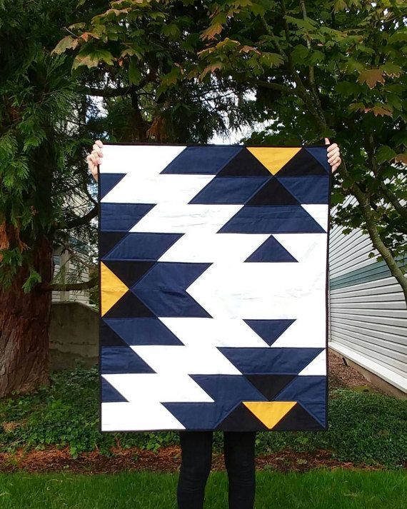This patchwork quilt was inspired by native american indian art and crafts. It is made from 100% cotton fabric and lightweight cotton batting. The colors in this quilt are dark blue, black, yellow and white. The backing part is gray. There are two available sizes: Small (Baby Size): 34 x 42 inches/ 86 x 107 cm Large (Full Size): 72 x 88 inches/ 182 x 224 cm The binding is hand stitched to the back in the traditional style. Production time for standard order is 3-6 business days for small ...