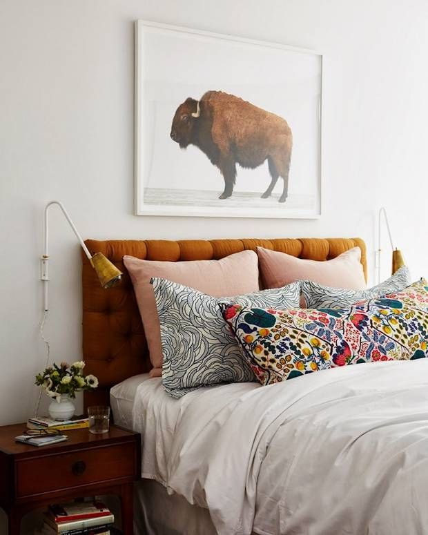 Make a statement in the bedroom by mixing and matching colours, patterns and textures. Stylish bedside lamps and a large print above the bed complete the look.
