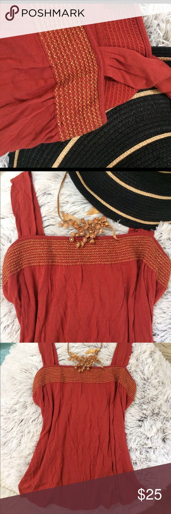 •ANN TAYLOR• lovely, swingy burnt orange top with beautiful gold smocking by liberty luxe for ann taylor! i cut the care tag out, so unsure of the fabric, but it is very soft and should be machine washable! Ann Taylor Tops Tank Tops
