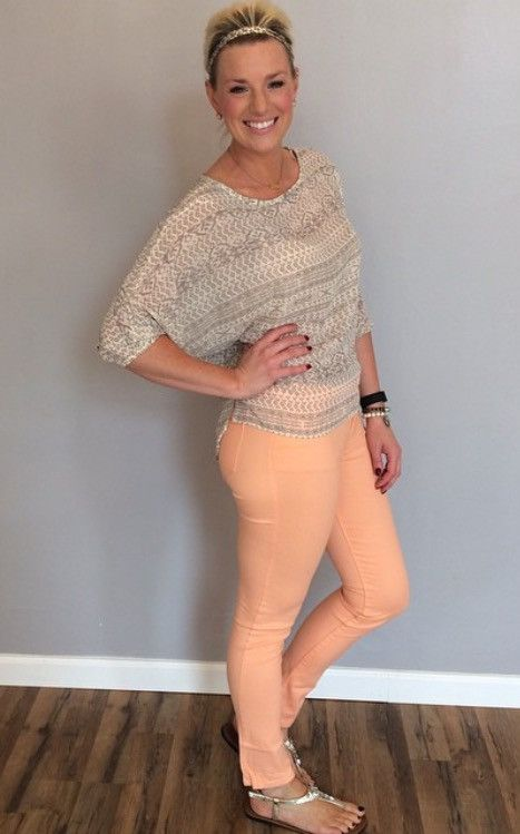 Peach colored skinny jeans. Runs about two sizes small.