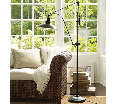Glendale Pulley Task Floor Lamp - Able to serve both the settee and an arm chair with its pivot function, this lamp recalls industrial style that has been softened by the curve of its neck and slightly rounded shade.   The dark metal finish would work well with the dark metal in the dining chairs.