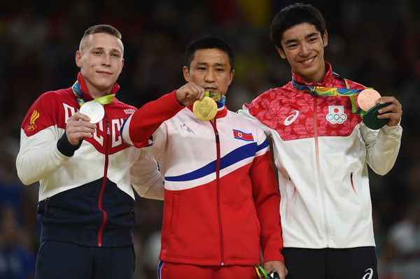 Silver medalist Denis Abliazin of Russia, gold medalist Se Gwang Ri of North Korea and bronze medalist Kenzo Shirai of Japan pose on the podium at the medal ceremony for Men's Vault on day 10 of the Rio 2016 Olympic Games at Rio Olympic Arena on August 15, 2016 in Rio de Janeiro, Brazil.