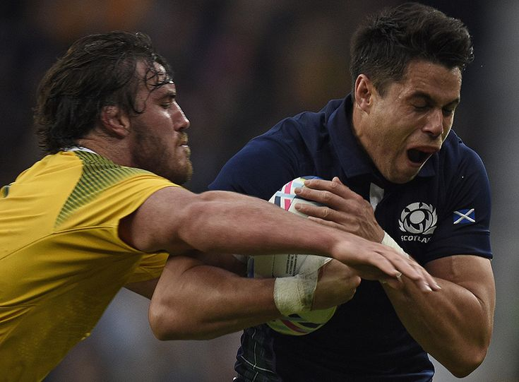 Scotland's wing Sean Maitland (R) is tackled by Adam Ashley-Cooper