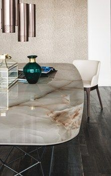 Totally drool worthy. This may be a ceramic judging by the blurb on their page. I am not sure. It really looks like alabaster though. Quite possibly glass laminated alabaster. Gordon by http://m.archiproducts.com/it/notizie/52312/cattelan-italia-2016-collection.html