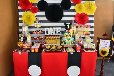 Mickey inspired first birthday table.  See more Mickey Mouse birthday ideas and birthday parties for kids at www.one-stop-party-ideas.com