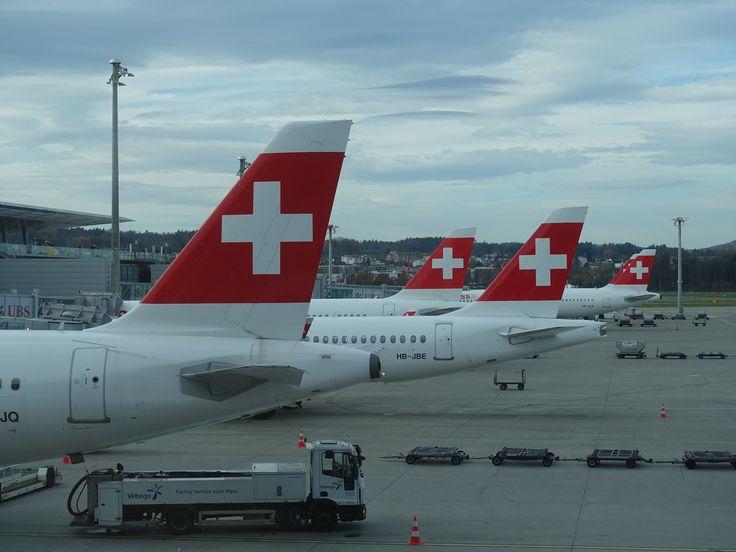 https://flic.kr/p/21Xqbys | 201711020 Zürich airport with LX airplanes | Zürich - Kloten airport concourse B  Plenty of swiss tails  Viele Schweizer Heckflossen  DSC02498
