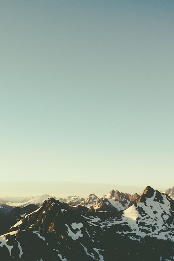 Snowy Peaks by Bronson Snelling The interaction of the earth and air - mountains reaching up through to the sky