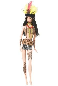 """Amazon Barbie Doll. This doll represents one of the many natives occupying Brazil. """"The Indigenous peoples in Brazil comprise a large number of distinct ethnic groups who inhabited the country prior to the European invasion around 1500. Unlike Christopher Columbus, who thought he had reached the East Indies, the Portuguese, most notably Vasco da Gama, had already reached India via the Indian Ocean route when they reached Brazil. As of 2007, there are 67 uncontacted tribes."""""""