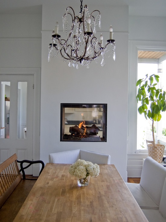 double sided fireplace between dining room and kitchen