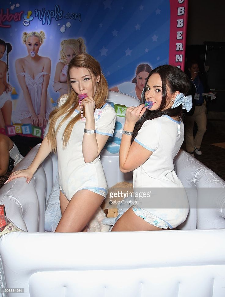Adult film actresses Baby Sarah (L) and Baby Brunette pose in an inflatable crib during the 2016 AVN Adult Entertainment Expo at the Hard Rock Hotel & Casino on January 22, 2016 in Las Vegas, Nevada.