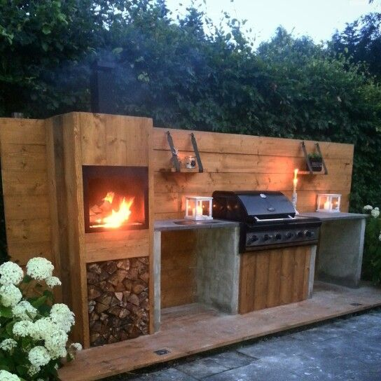 Outdoor kitchen with natural wood and stone