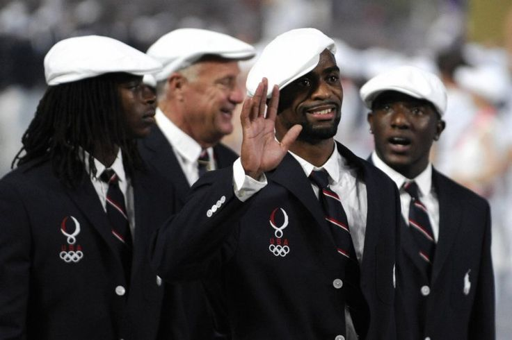 "US athlete Tyson Gay (C) and members of the Olympic delegation of the United States of America parade during the opening ceremony of the 2008 Beijing Olympic Games at the National Stadium, also known as the ""Bird's Nest"", on August 8, 2008.   The 2008 Summer Games opened in China and will run until from August 24."