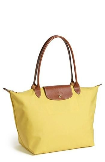 Loving the yellow on this longchamp Le Pliage!