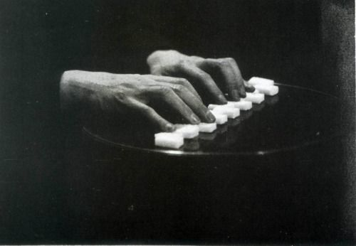Man Ray  year: 1922  Theme: Compositions  Antonin Artaud's hands sugar piano table