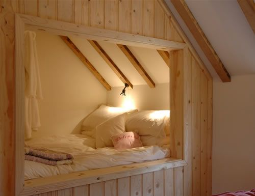 Loft bed--cozy! Would be cute in remodeled attic space, a guest room, or even a childs bedroom :-)