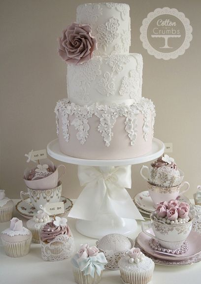 Pretty Lace & Blossom. The lacework on this wedding cake from Cotton and Crumbs is just so impossibly beautiful.