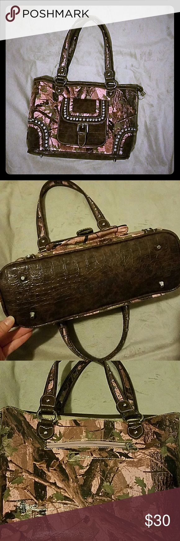 Beautiful camo purse Only used a few times. In perfect condition from a boutique near me. Camo Bags