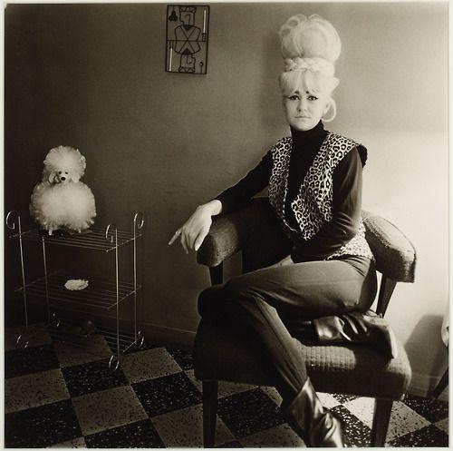 DIANE ARBUS (1923-1971) -    Lady bartender at home with a souvenir dog, New Orleans, La., 1964  gelatin silver print