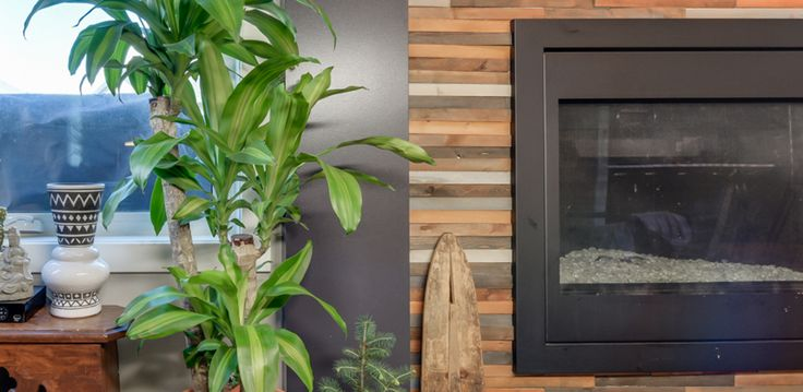 Kimberley Homes and Crave Interiors Feature this Fireplace DIY. How to make this unique fireplace surround using wood shims.  #fireplace  #kimberleyhomes #buildwithkimberley #vignettephotography #vignette #houseplants #plants #bohemian #bohemianstyle #bohemiandecor #bohemianhome #boho #bohostyle#interiordesign #interiordesignideas #interiorstyling #interiordecor #designblog #decorblog #CustomHomeBuilder #newhome #newhomeconstruction #yeg #realestate