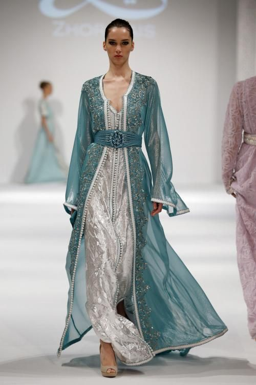 Magnificently stunning - <3<3<3 gorgeous silvery sleeveless maxi with teal flowy overcoat & soft open cuffs from: Zhor Rais - Muscat Fashion Week 2013