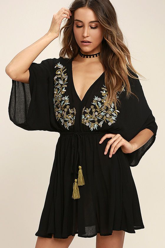 Lulus Exclusive! Bring your vacation dreams to life with the Belize in Magic Black Embroidered Dress! Gauzy rayon sweeps across a V-neck (with olive, mint, and pink embroidery), to kimono sleeves, and elasticized, drawstring waist with tassels. Relaxed mini skirt.