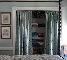 diy closet doors - curtains as doors- like the moulding idea to frame it.