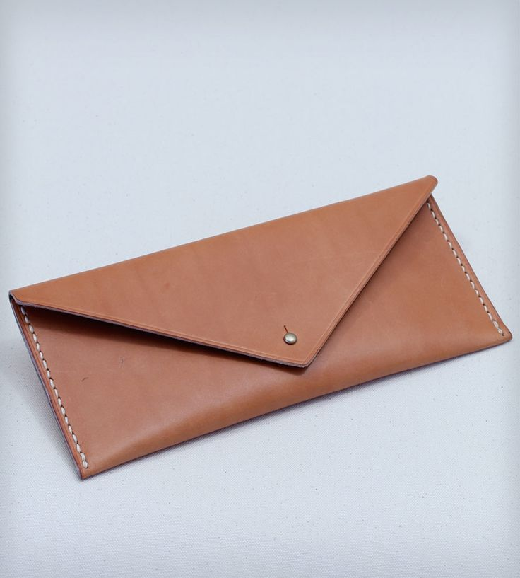 Hand Stitched Leather Travel Clutch by W Durable Goods on Scoutmob Shoppe. Hand stitched leather travel clutch is made from vegetable tanned leather with an easy button stud closure.