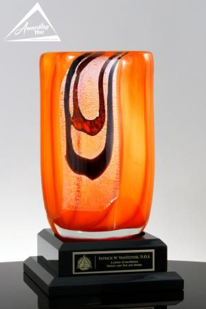 The Bijou is an outstanding Art Glass Award. Art glass awards are handmade, and each award will be slightly different in size, shape and color. They are great options when you want to add really unique and colorful awards to your program.  This award is 10 inches tall and rests on (not adhered to) a black wood base which has a nice amount of engraving space for your logo and award text.  The Award is very popular for Sponsor Recognition, Donor Recogntion, Thank You Gifts, and Sales Awards.
