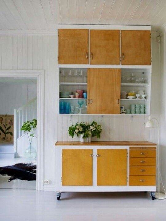 Matching wall-mounted and movable cabinets