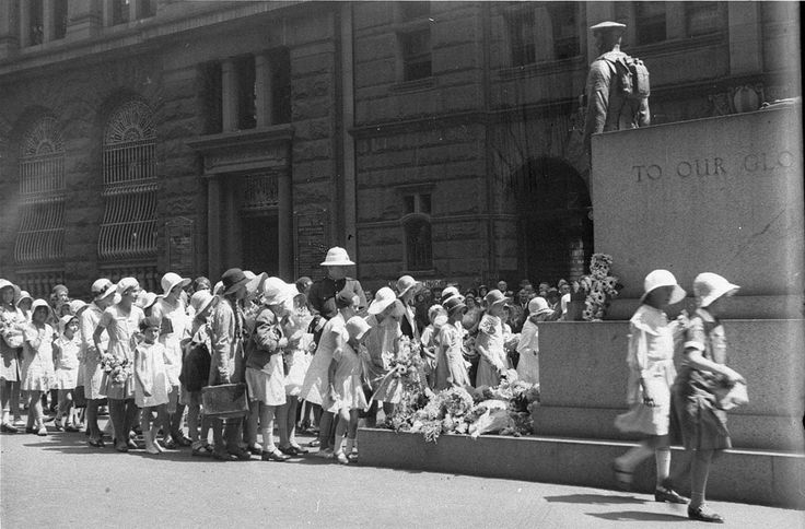 Children march past the Cenotaph in Martin Place  on Anzac Day in the 1930s. Photograph by Ted Hood. From the Mitchell Library, State Library of New South Wales : http://www.acmssearch.sl.nsw.gov.au/search/itemDetailPaged.cgi?itemID=51066