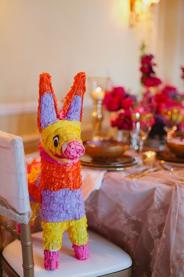 Pinata #Mexico   Photo: www.janiceyiphotography.ca   Wedding Planner: www.traceymevents.ca Featured on: Wedding Obsession Wedding Blog http://www.weddingobsession.com/2014/01/29/luxurious-mexico-inspired-style-shoot/