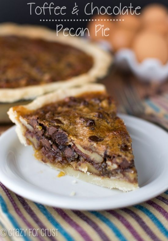 This Toffee Chocolate Pecan Pie Recipe is from my Mom's Pecan Pie. It's filled with chocolate and pecans and toffee bits! #delicious #recipe #cake #desserts #dessertrecipes #yummy #delicious #food #sweet