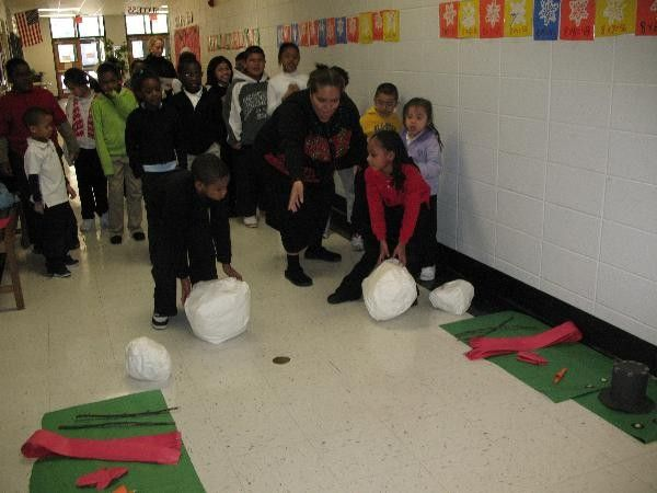 they used stuffed pillow cases and did a relay race to see what team can build the snowman the fastest--super cute since my Florida kids never get to build a real one!