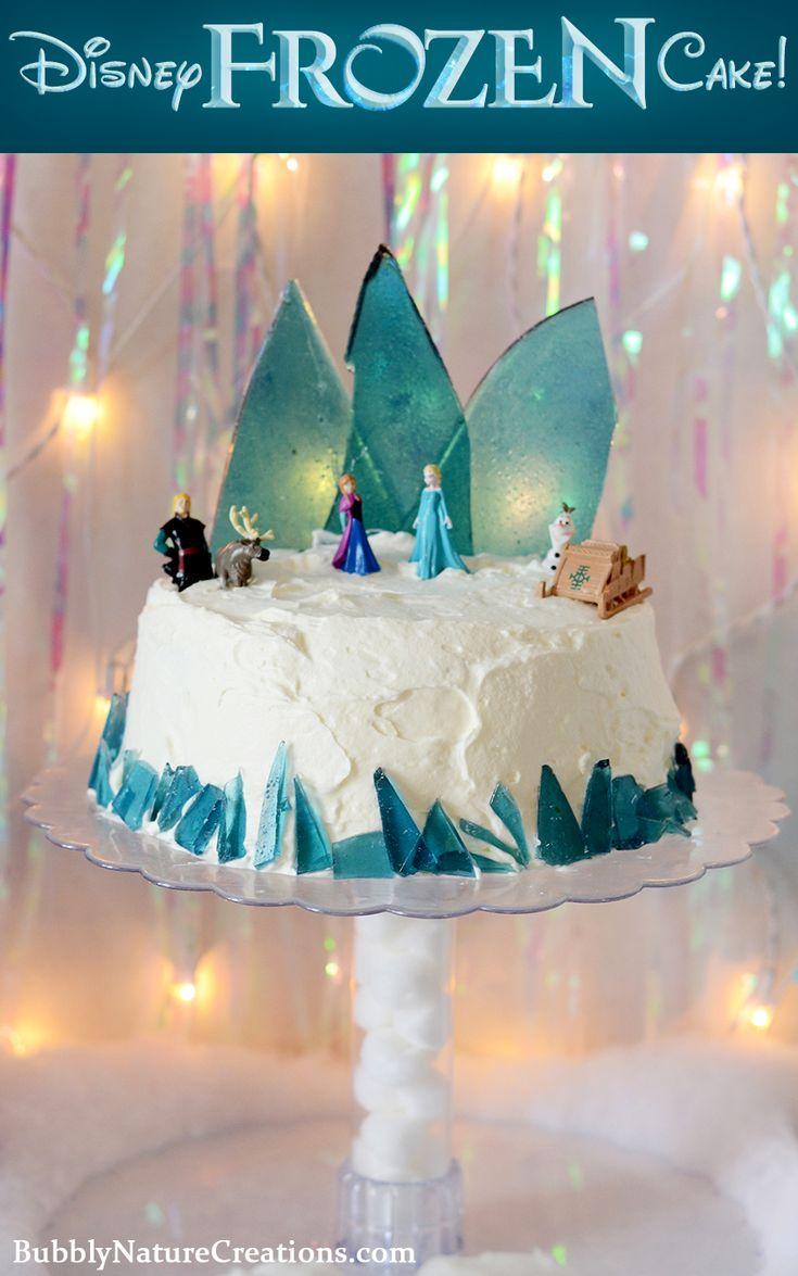 "Disney FROZEN Cake! So cool! ice cream hidden inside makes this a really frozen cake, plus the blue candy ""ice"" is super neat!"