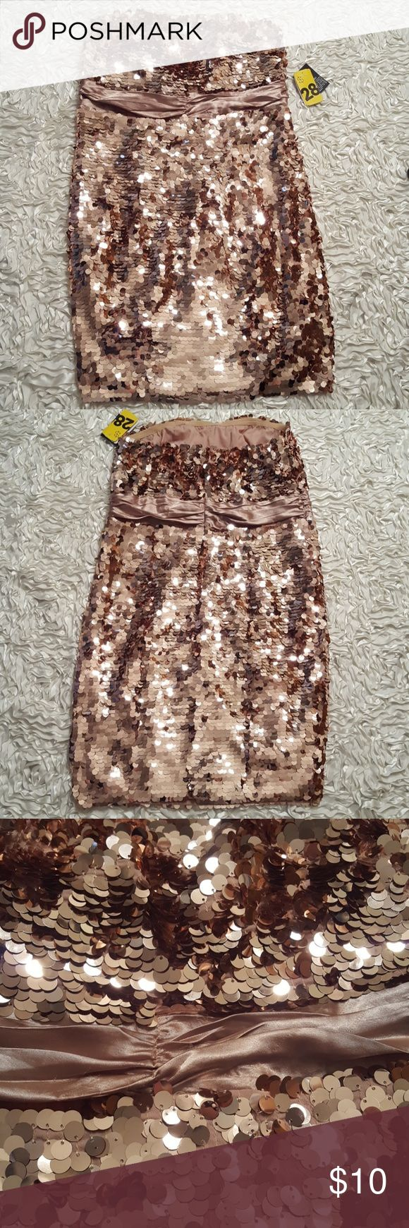 Sequined rose gold strapless cocktail length dress If you want a festive rose gold squined party dress look no further! This strapless number is hot to trot :) There are a few very small snags on the ribbon under the bust but are not noticeable.  NWT, smoke free home. Forever 21 Dresses