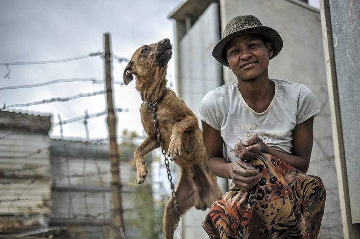 Kaaitjie Van Rooyen poses with her dog Lastig. The treatment of animals reflects the dire situation of their owners.
