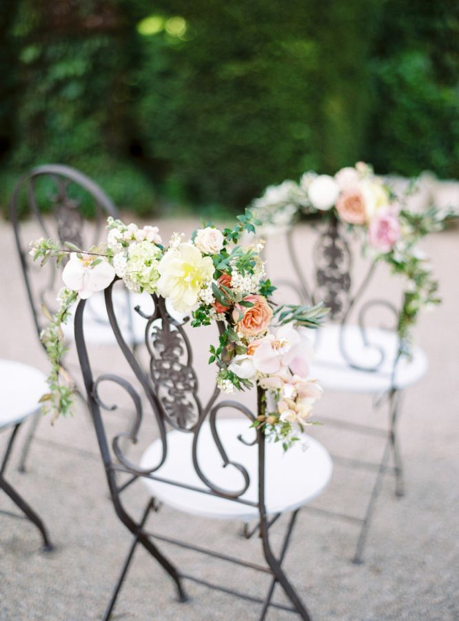 Floral accented ceremony chairs: http://www.stylemepretty.com/destination-weddings/2016/06/27/the-sweetest-spanish-wedding-weve-ever-seen/ | Photography: Muravnik Photography - http://www.marinamuravnik.com/