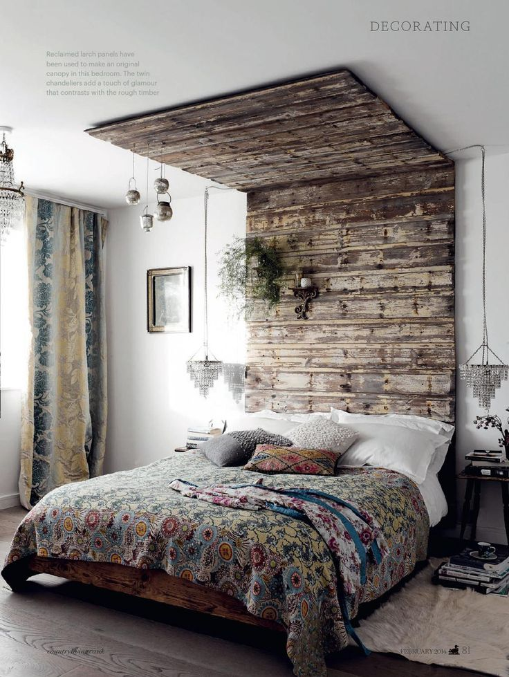 Wooden pallet headboard that goes all the way to the top. Edgy yet homely feels.