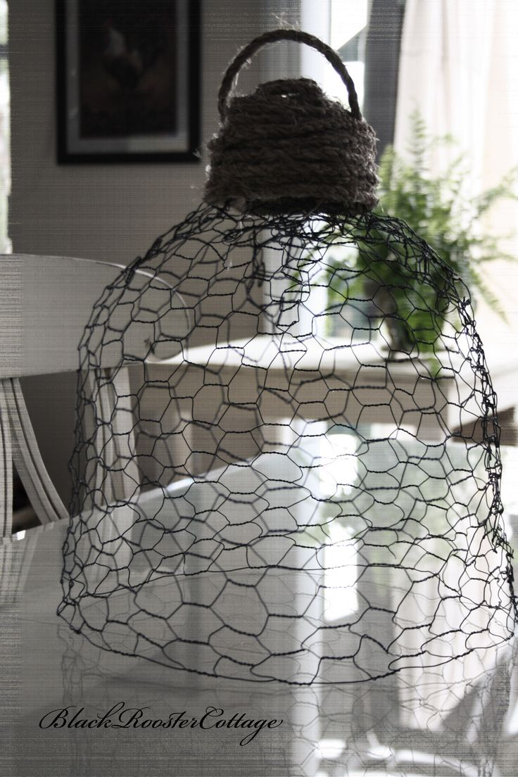 Chicken wire Cloche. Use door knob or drawer pull for the top.